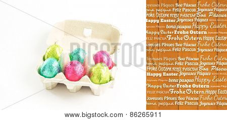 Happy easter in different languages against wooden planks
