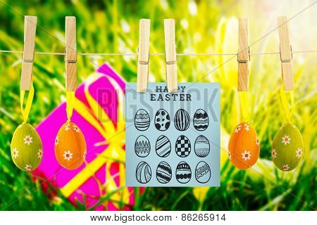 happy easter graphic against pink gift with easter egg and yellow tulip