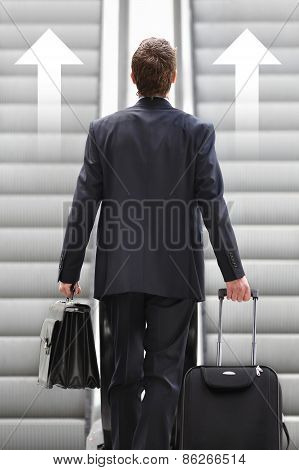 Businessman Front Escalator With Arrows