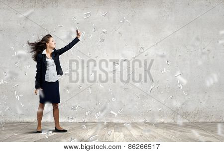 Young businesswoman screaming with rage in mobile phone