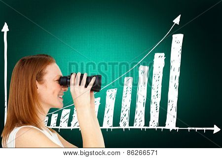 Charismatic businesswoman predicting future success against digitally generated grey background