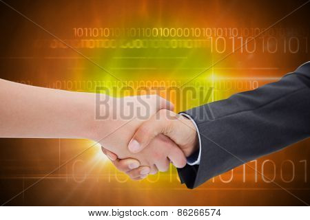 Close up of a handshake against blue technology design with binary code