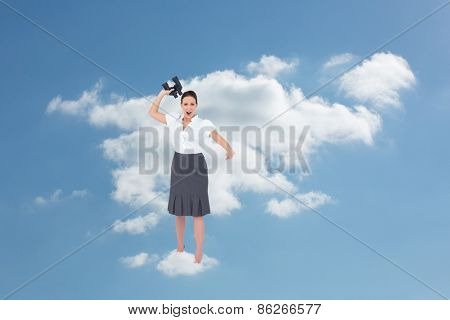 Angry businesswoman throwing binoculars away against cloudy sky