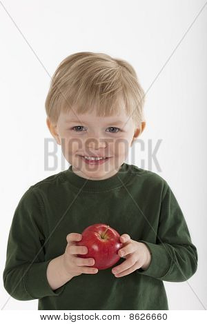 Young Boy Holding an Apple
