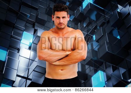 Bodybuilder posing against blue and black tile design