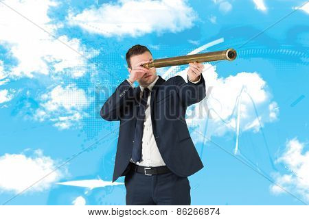 Businessman looking through telescope against stocks and shares