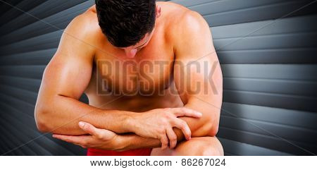 Bodybuilder posing against grey shutters