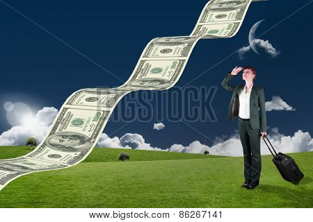 Businesswoman with suitcase against field and sky