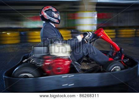 Man karting in formalwear