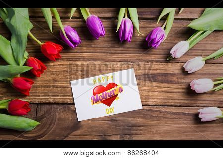 mothers heart against tulips with card