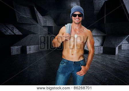 Attractive bodybuilder against dark room