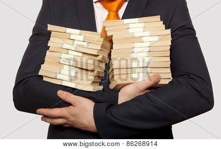 Businessman holding a stack of cash