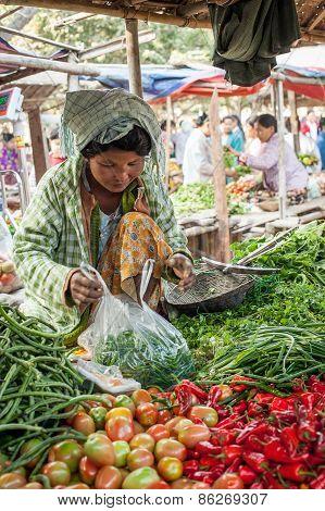Woman Selling Greengrocery At Asian Market. Bagan, Myanmar