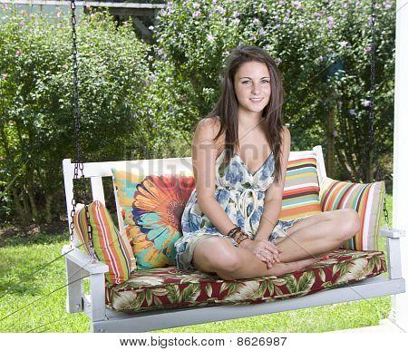 Girl Sitting on Swing