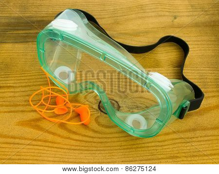 Protective Eyeglasses And Ear Plugs