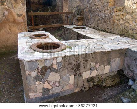 Ruins Of An Ancient Restaurant At Herculaneum