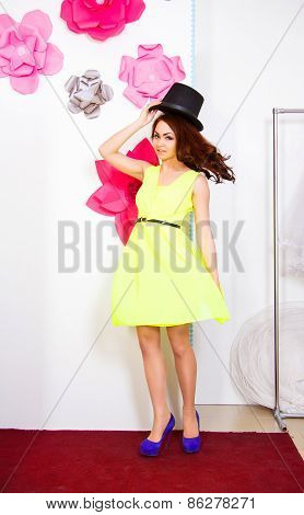 Happy Young Woman In A Top Hat