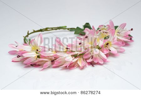 tiara of artificial  roses on a light background
