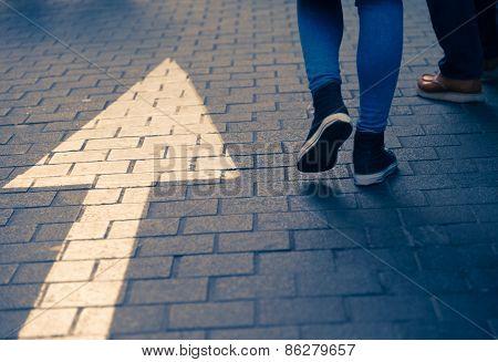 Arrow Straight On Street With Walking People