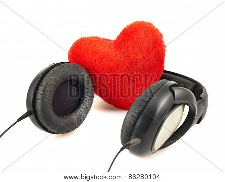 Headphones next to a red heart composition
