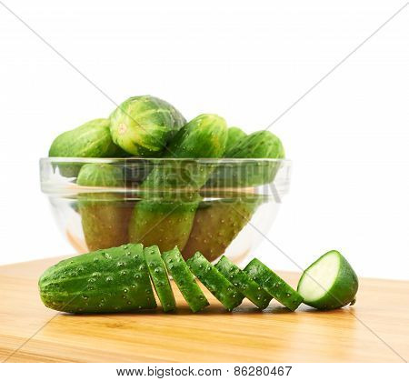 Sliced cucumbers over a cutting board