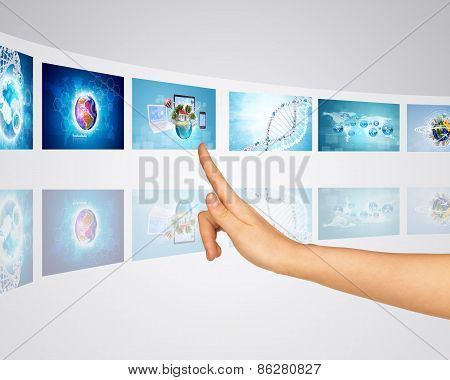 Theme of communication and world. Finger presses virtual screens