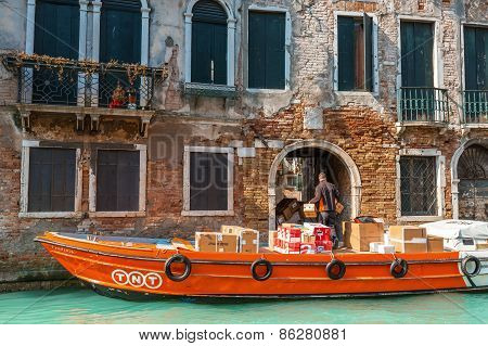 Venice, Italy - Mar 19 - Tnt Boat Package Delivery On Mars 19, 2015 In Venice, Italy.