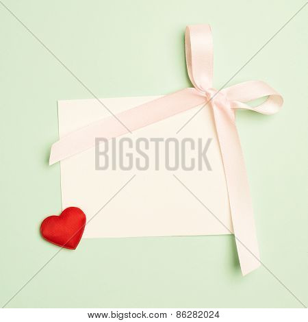 Empty greeting card over a mint green background