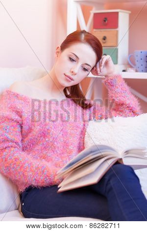 Girl In Pink Sweater With Book