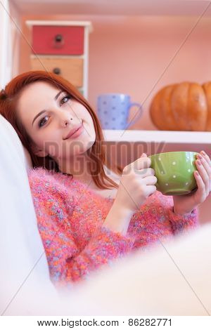 Girl In Pink Sweater With Cup