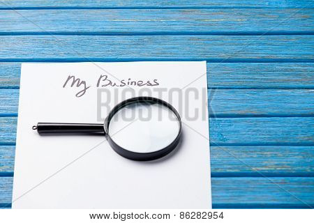 Loupe And Paper With My Business Words