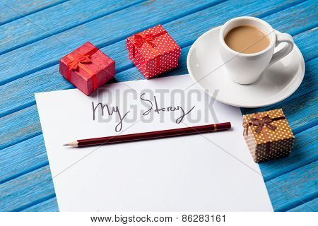 Pencil And Paper With My Story Words Near Cup