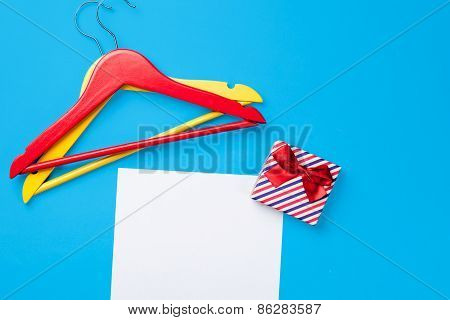 Hangers And Gift Near Paper