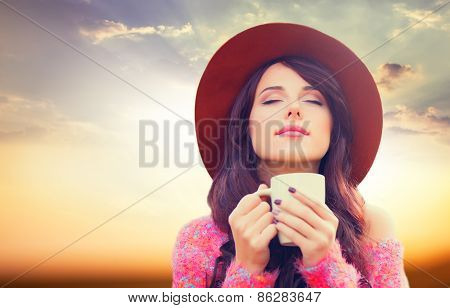 Redhead Girl In Hat With Cup Of Drink
