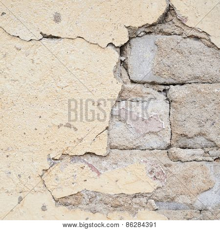 Brick wall with the whitewash falling off