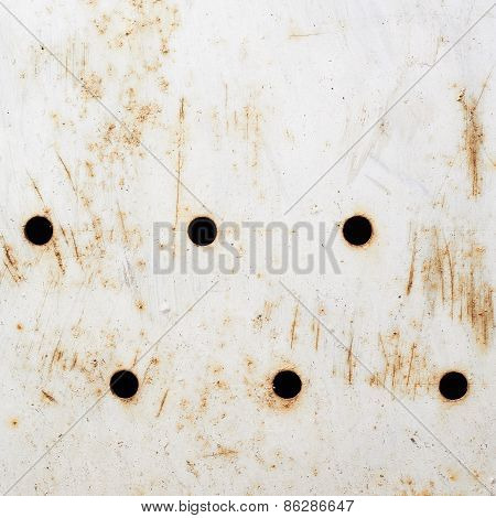 White painted rusty metal surface