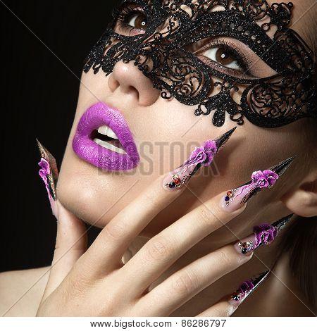 Beautiful girl with long nails and sensual lips.