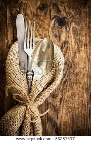 Flatware The Old Wooden Table With A Rustic Style.