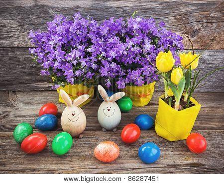 Easter decoration. Easter eggs, bellflowers, tulips, rabbit