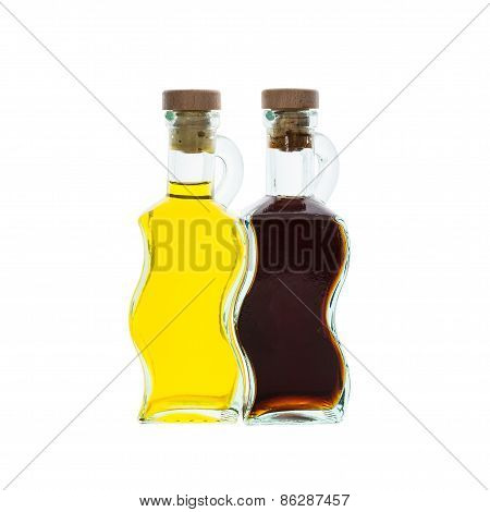 Olive Oil And Vinegar In Glass Bottles Isolated Over White