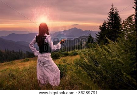 Mystic Woman In Ancient Dress Alone In A Romantic Sunset Landscape