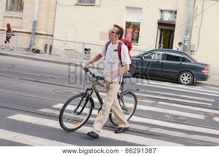 Tourist Crossing The Crosswalk