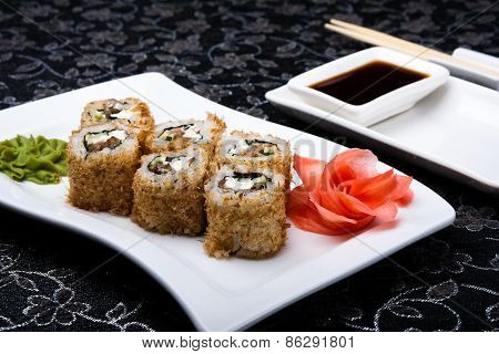 California Roll Sushi With Pickled Ginger,vasabi And Soy Sauce In The Plate