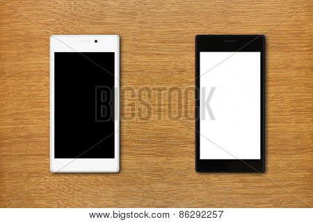 Black And White Smartphones On The Table