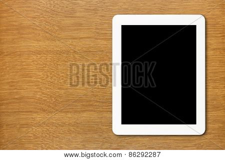 White Tablet Pc With Black Screen On The Table