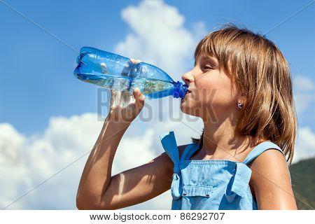 Young Beautiful Girl Drinking Water