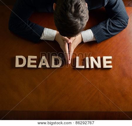Word Deadline and devastated man composition