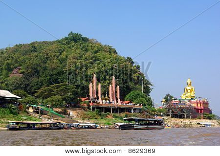 Statue Of Buddha On River Mekong