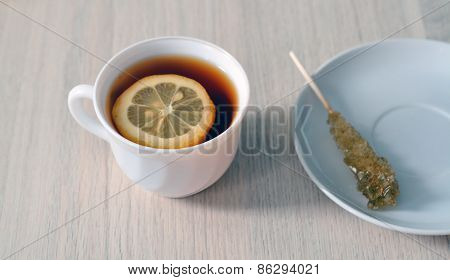 Cup Of Tea With Lemon And A Sugar Stick