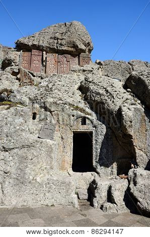 Cross-stones And Entrance To Monastic Cells Of Geghard Rock Monastery,armenia, Caucasus, Unesco